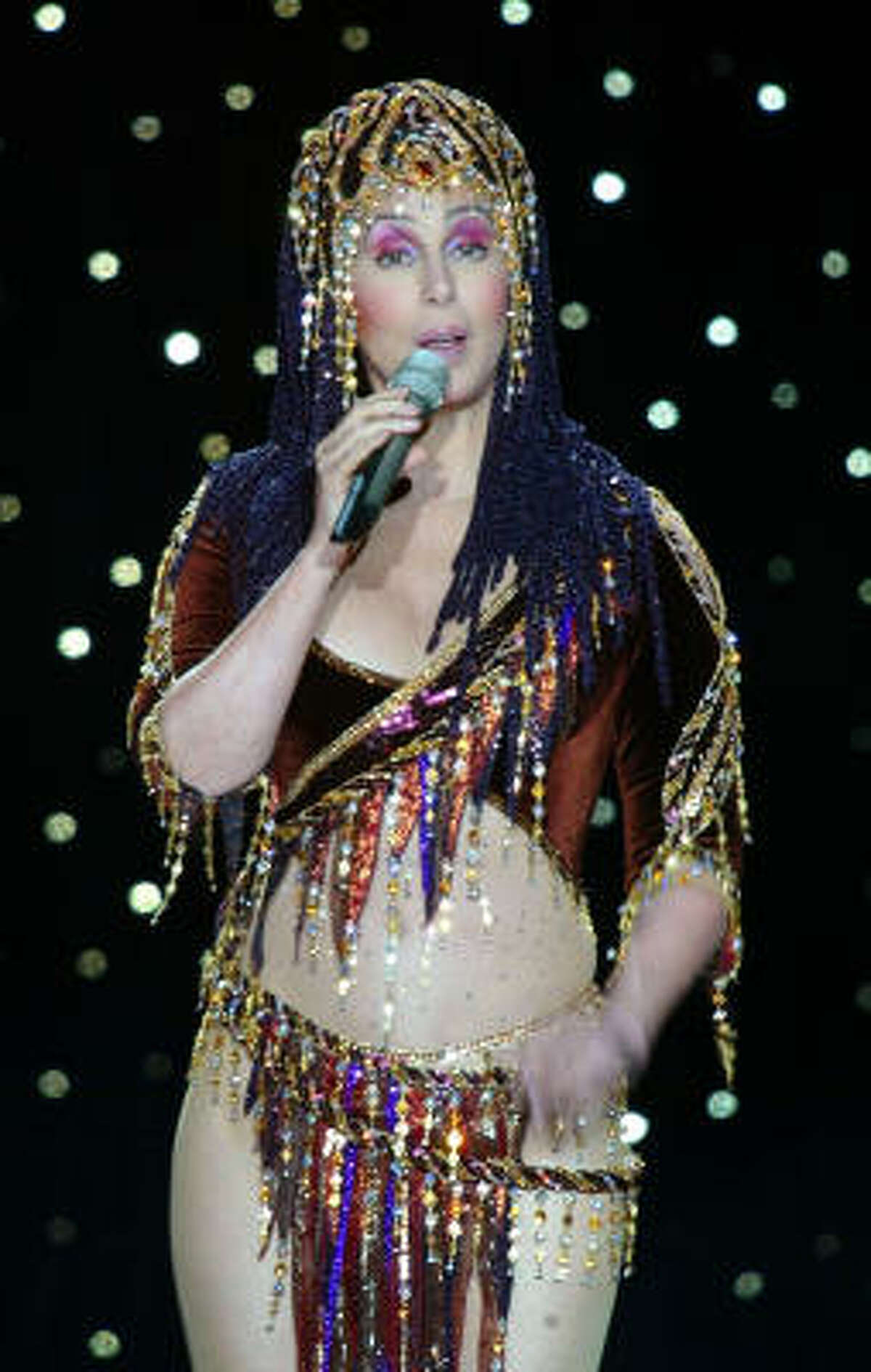 **FILE**Cher performs during her concert in Moscow, which is part of the diva's current farewell tour, on June 21, 2004. Cher announced that her current tour would be her last.