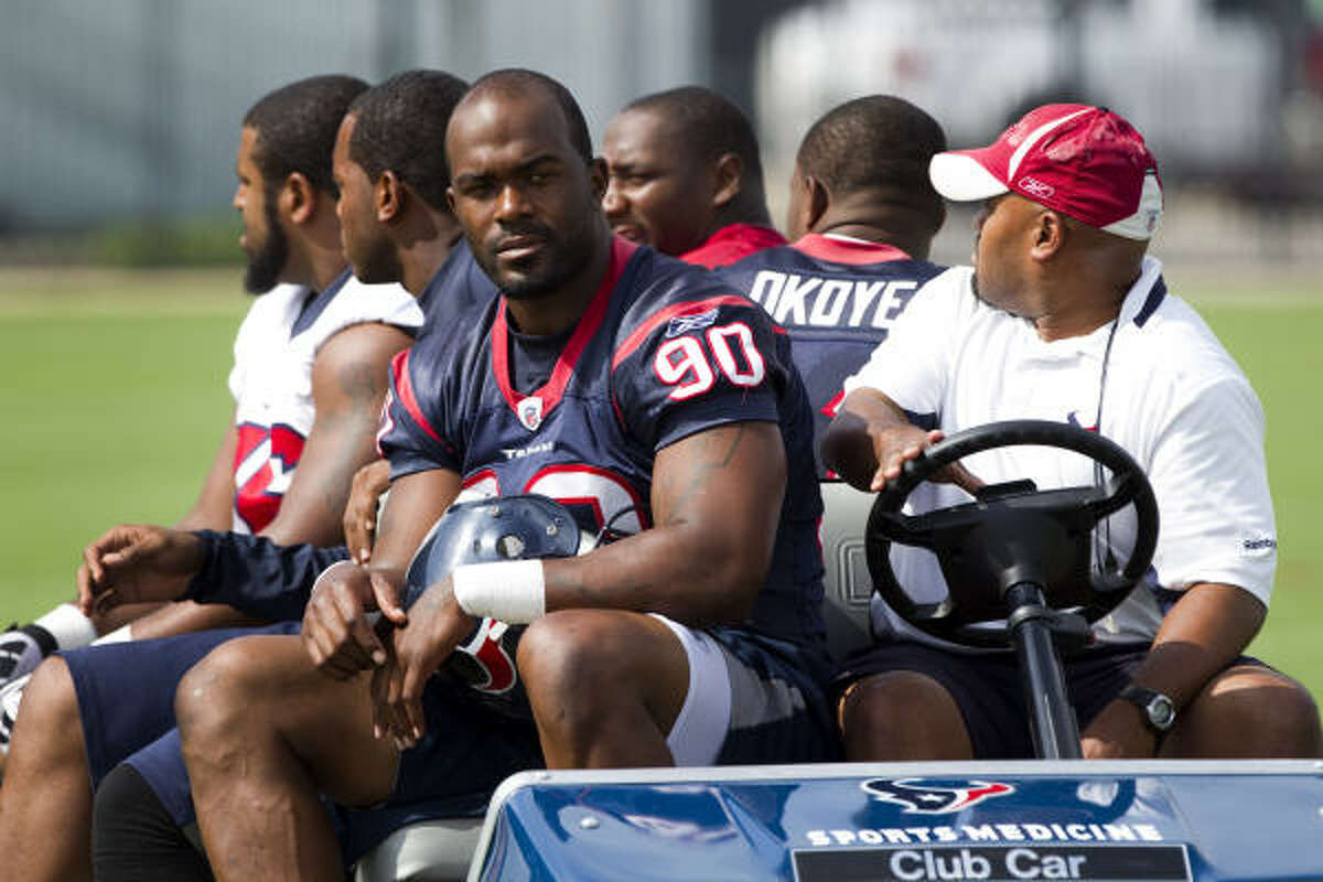 Texans defensive end Mario Williams gets a ride to practice with some teammates.