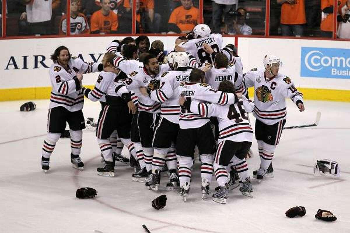 Game 6: Blackhawks 4, Flyers 3 (OT) The Chicago Blackhawks celebrate after teammate Patrick Kane scored the game-winning goal in overtime.