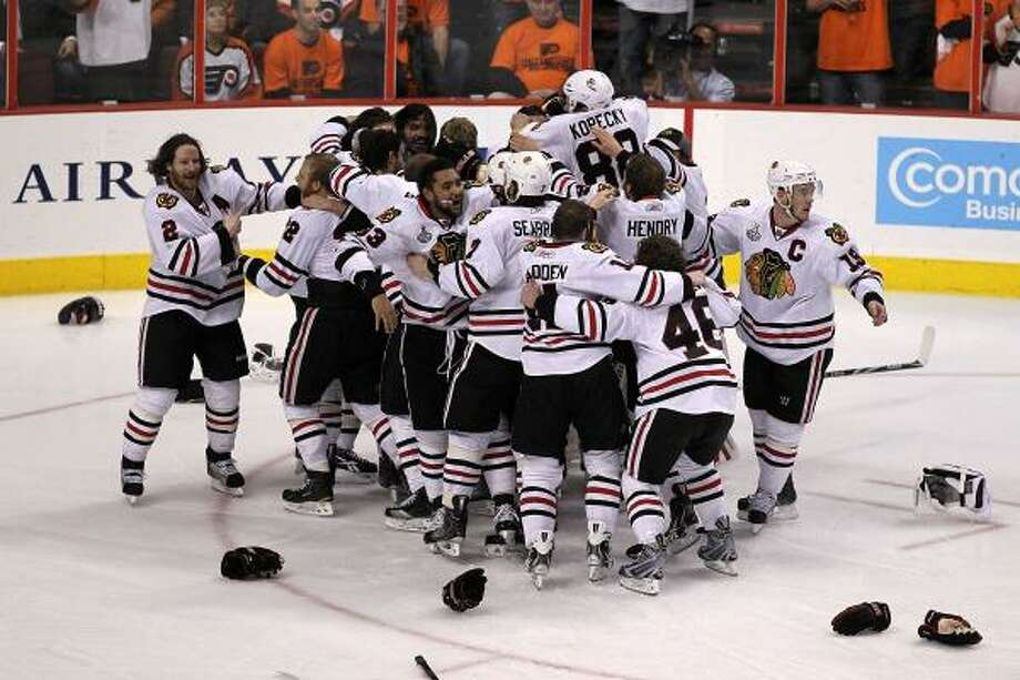 Game 6: Blackhawks 4, Flyers 3 (OT) The Chicago Blackhawks celebrate after teammate Patrick Kane scored the game-winning goal in overtime. Photo: Al Bello, Getty Images