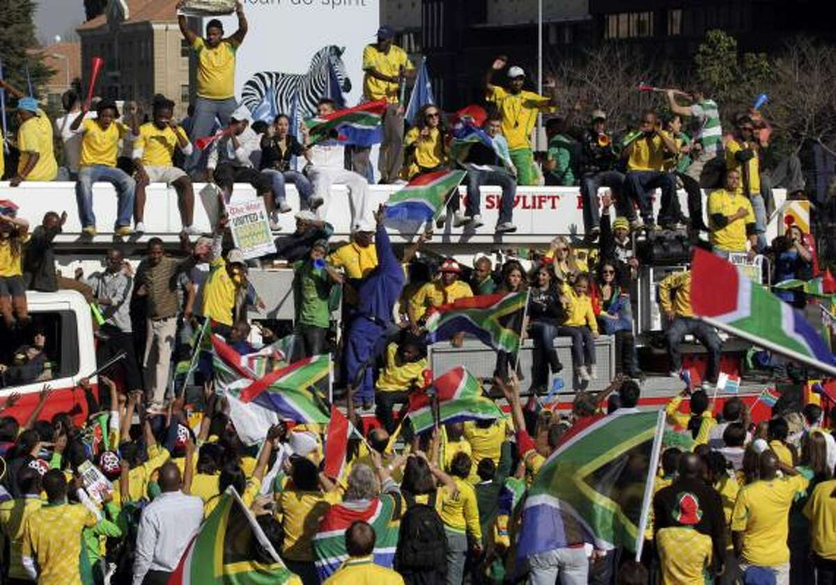 Fans cheers on the South African soccer team during a parade through Sandton, Johannesburg.