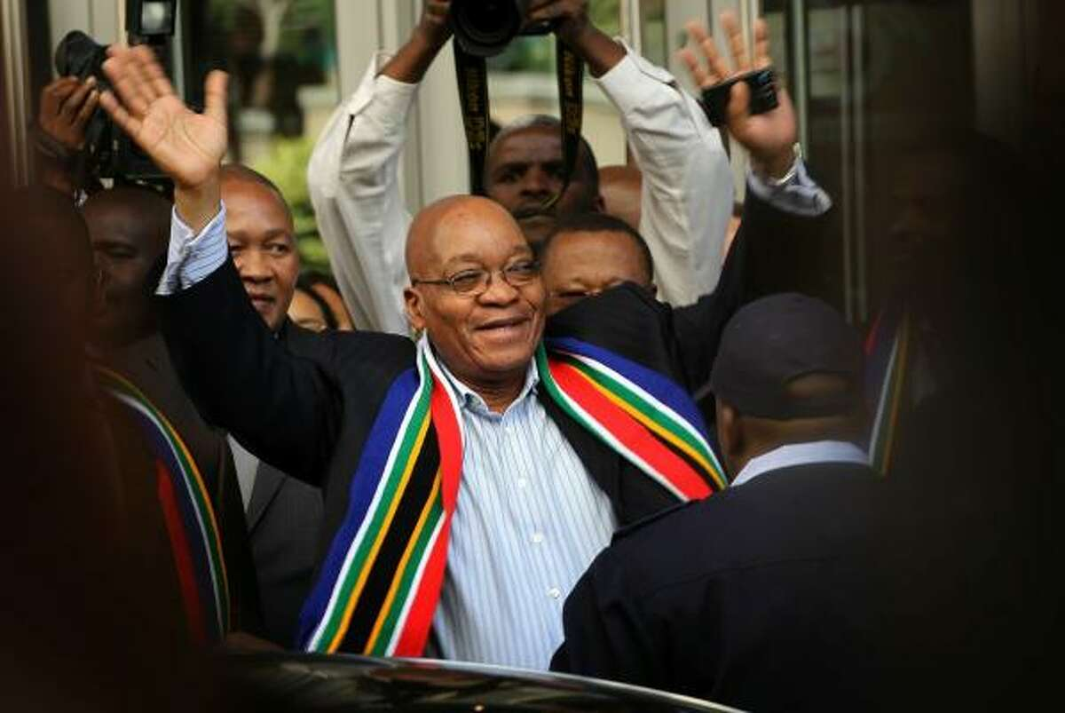 South African President Jacob Zuma waves to fans.