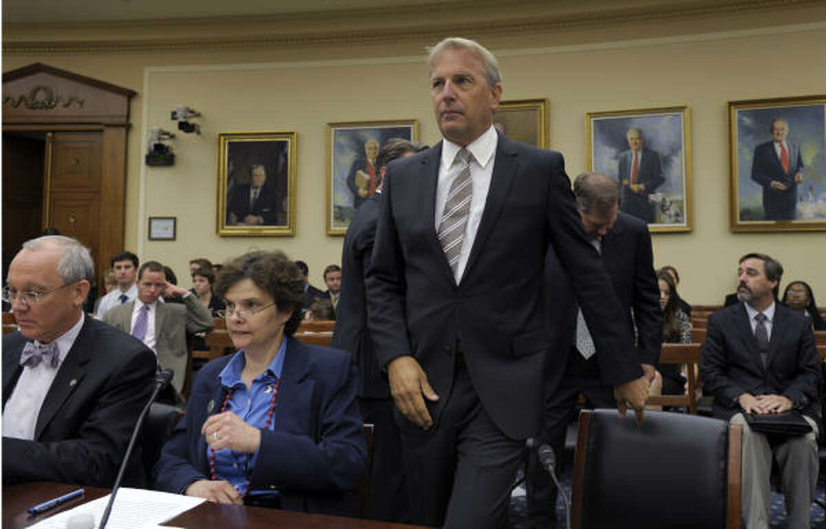 Actor Kevin Costner, a partner in cleanup technology firm Ocean Therapy Solutions, arrives on Capitol Hill on Wednesday, June 9, 2010, to testify before a House subcommittee hearing on the effectiveness of oil spill cleanups. From left are, Dr. Richard Hunt, senior research scientist at the Houston Advanced Research Center, Dr. Nancy Kinner, co-director of the Costal Response Research Center at the University of New Hampshire, and Costner.