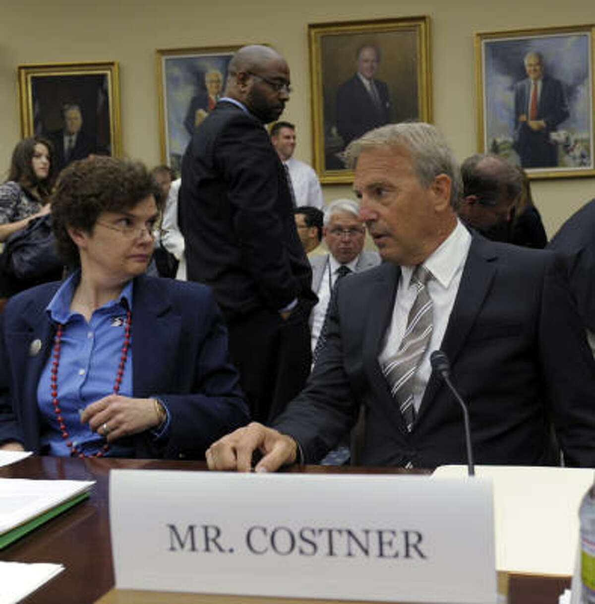 Actor and partner of Ocean Therapy Solutions Kevin Costner, right, talks with Dr. Nancy Kinner, co-director of the Costal Response Research Center at the University of New Hampshire, on Capitol Hill on Wednesday, June 9, 2010, prior to testifying before a House subcommittee hearing on the effectiveness of oil spill cleanups.