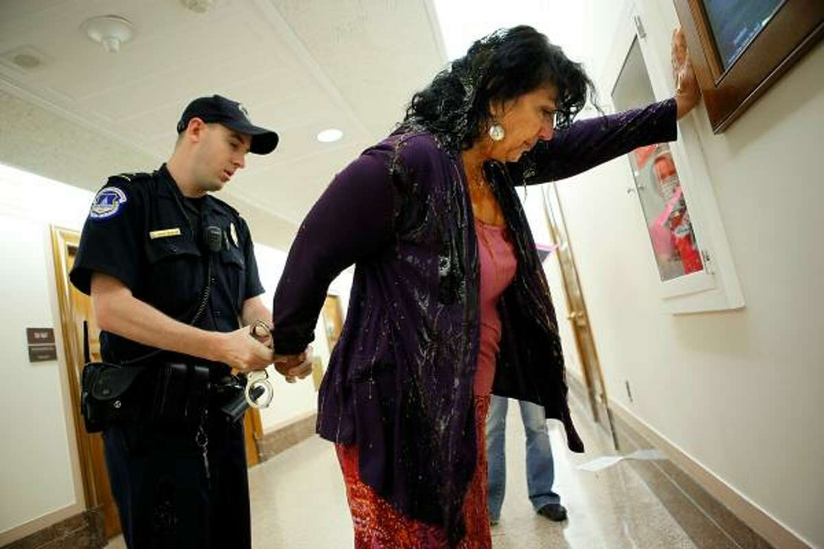 Diane Wilson of Seadrift, Texas, is handcuffed after interrupting a Senate Energy and Natural Resources Committee hearing on June 9, 2010. Interior Secretary Ken Salazar testified before the committee about the Obama Administration's increased safety regulations for energy exploration on the Outer Continental Shelf in the wake of the ongoing oil spill in the Gulf of Mexico.
