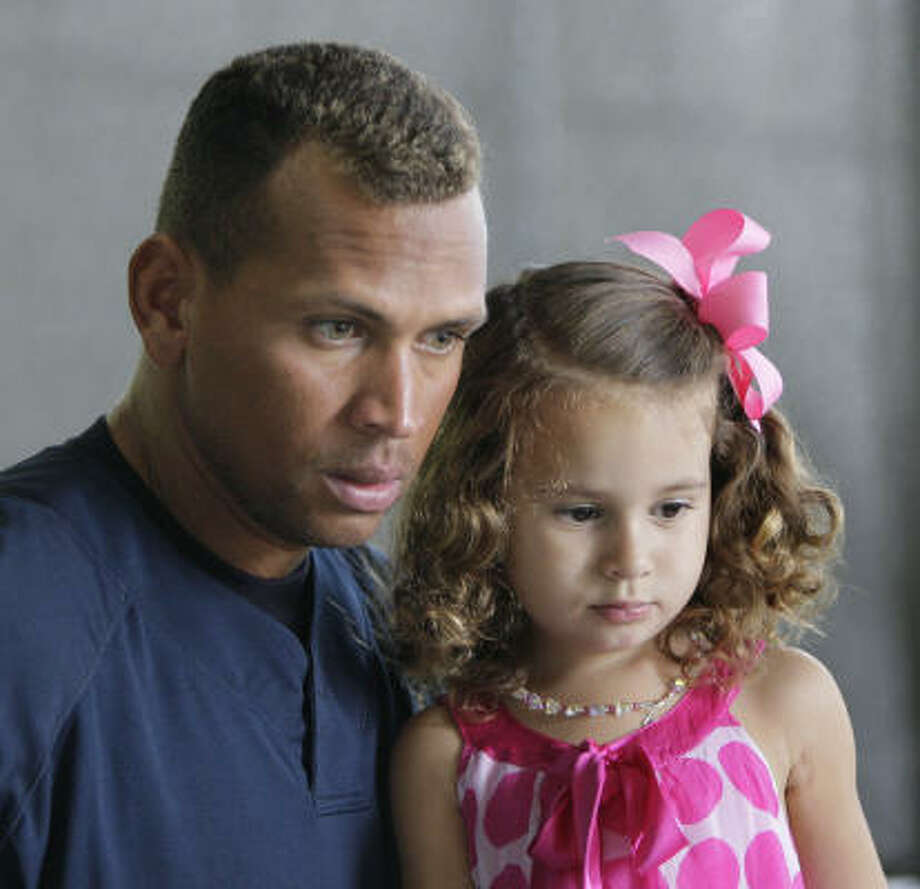 Here he is with his daughter Natasha whom he had with his wife. Photo: Julie Jacobson, AP