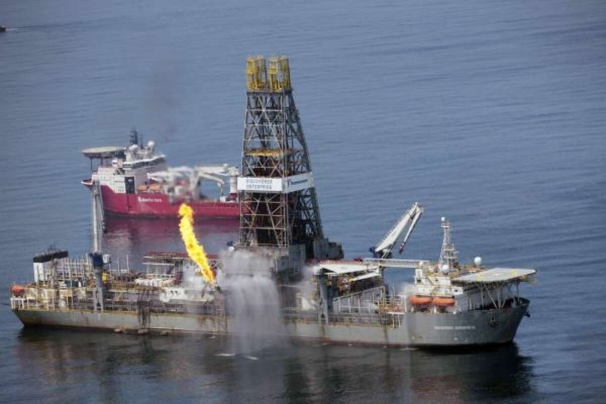 The Transocean Discoverer Enterprise burns off some natural gas as it takes on oil from the broken BP wellhead Tuesday.
