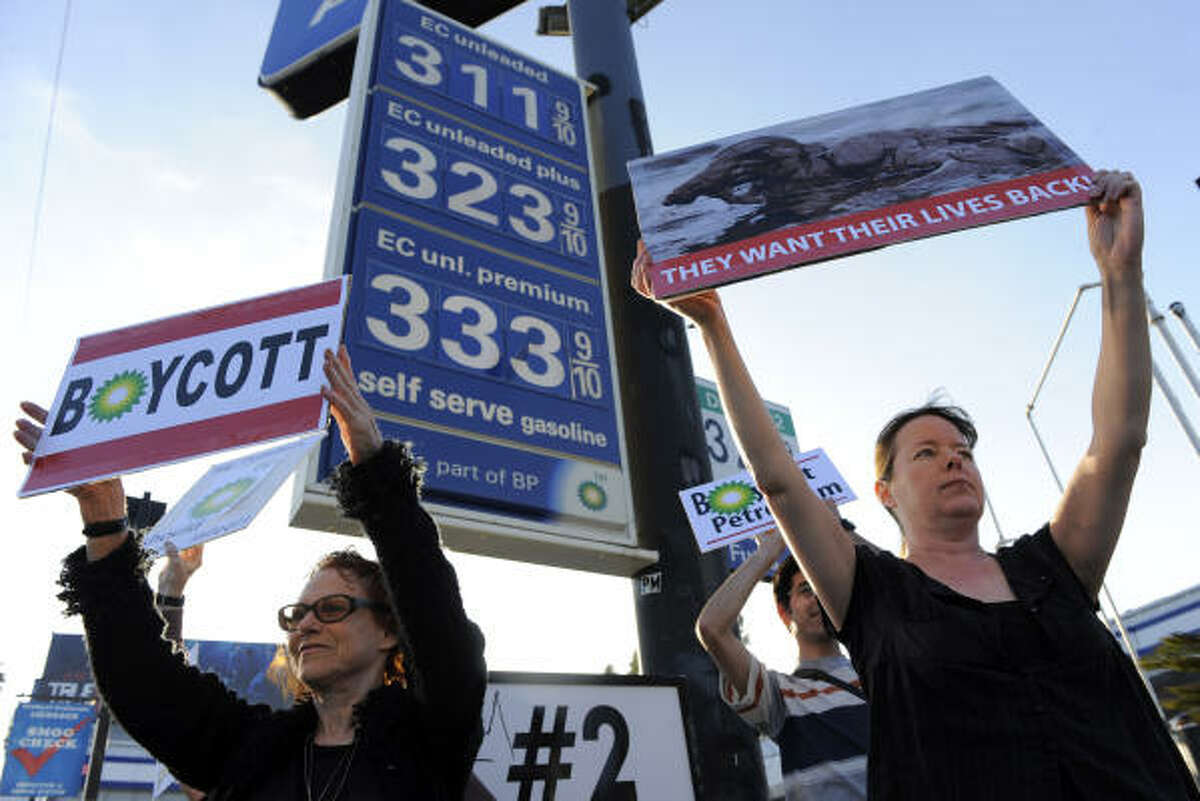 Elaine Jesmer, left, and Heather Crosson, both of Los Angeles, protest against BP in an event organized by Moveon.org outside an Arco gas station Tuesday.