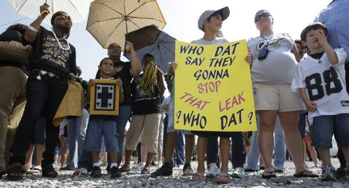 Fans await the arrival of the New Orleans Saints on Tuesday, June 8, 2010 in Buras, La. The Super Bowl champions made a visit to the area to boost morale as the Gulf Coast grapples with an epic oil leak offshore.