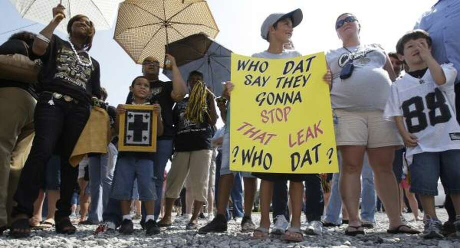 Fans await the arrival of the New Orleans Saints on Tuesday, June 8, 2010 in Buras, La. The Super Bowl champions made a visit to the area to boost morale as the Gulf Coast grapples with an epic oil leak offshore. Photo: Eric Gay, AP