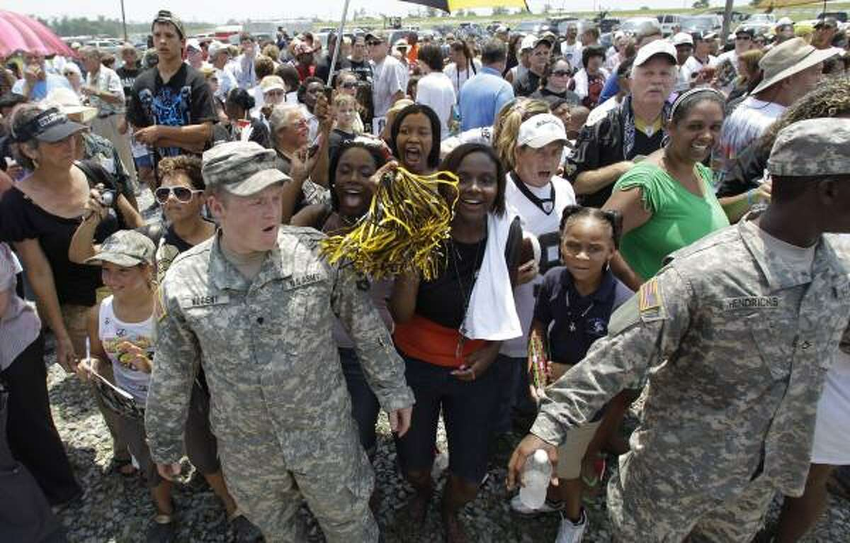 National Guard soldiers help control the crowd during a New Orleans Saints rally in Buras, La., on Tuesday, June 8, 2010. The Saints hoped to boost morale in coastal communities affected by the BP oil spill.