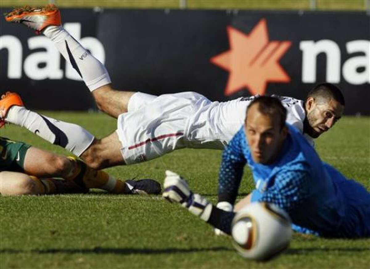 Clint Dempsey of Nacogdoches falls as he watches his attempt on Australia goalkeeper Mark Schwarzer go wide of the net.