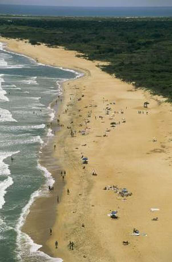 Cape Hatteras on Hatteras Island is one of the barrier islands of the Outer Banks of North Carolina. The Outer Banks --where pirate Blackbeard once roamed-- is a popular place for family beach vacations. Families can swim, fish, camp, windsurf, go boating, explore a National Wildlife Refuge, or visit the black-and-white striped Cape Hatteras Lighthouse. Photo: AP