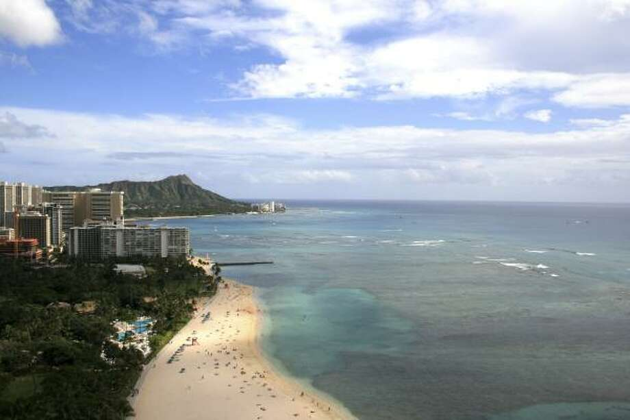 "Waikiki Beach is one of the world's most popular beaches. It's actually a two-mile stretch with nine individually named beaches; Kahanamoku Beach is at the north end. Dr. Beach says: ""A shallow offshore reef protects this beach from the big waves, making it a great swimming area for families with children."" Photo: AP"