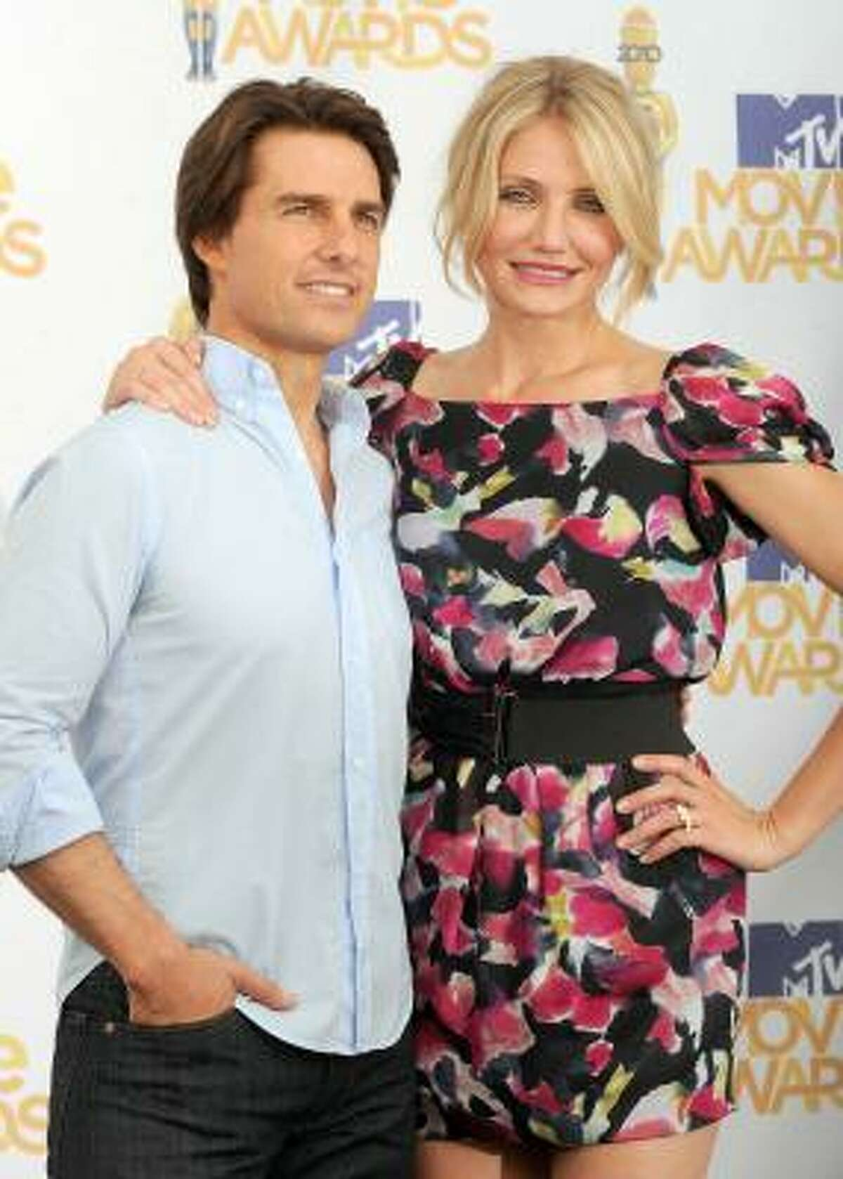 Tom Cruise's look was noticeably different performing than when he arrived earlier and took pictures with Cameron Diaz in the press room.