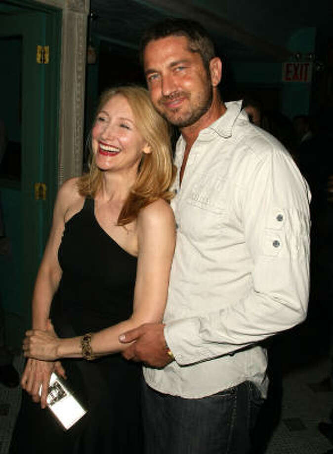 Here he is getting friendly with Patricia Clarkson. Photo: Andrew H. Walker, Getty Images