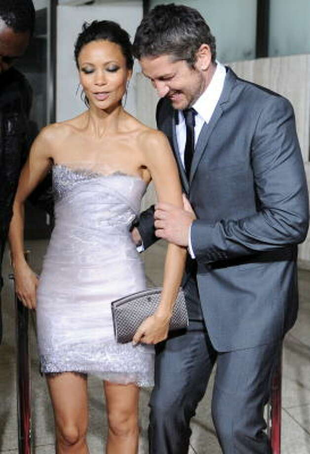 Never fear. If a woman trips, he'll be there to catch her...as he's done here with Thandie Newton . Photo: JEWEL SAMAD, AFP/Getty Images