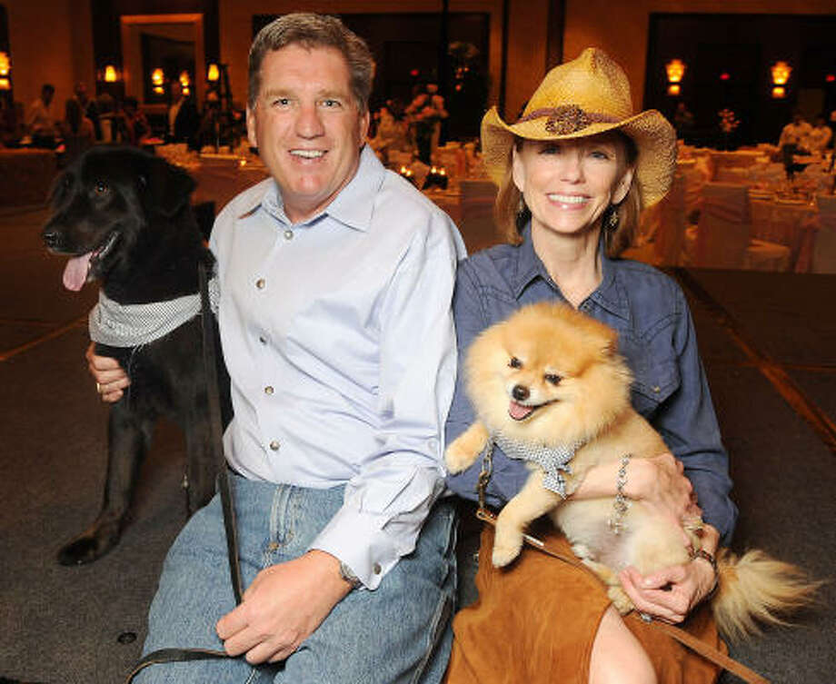 "Patrick Gehm with Grayson and Susan Krohn with Finny at Mr. Magoo's ""The Best Little Doghouse in Texas"" benefitting the Citizens for Animal Protection at the Hilton Americas-Houston. Photo: Dave Rossman, For The Chronicle"