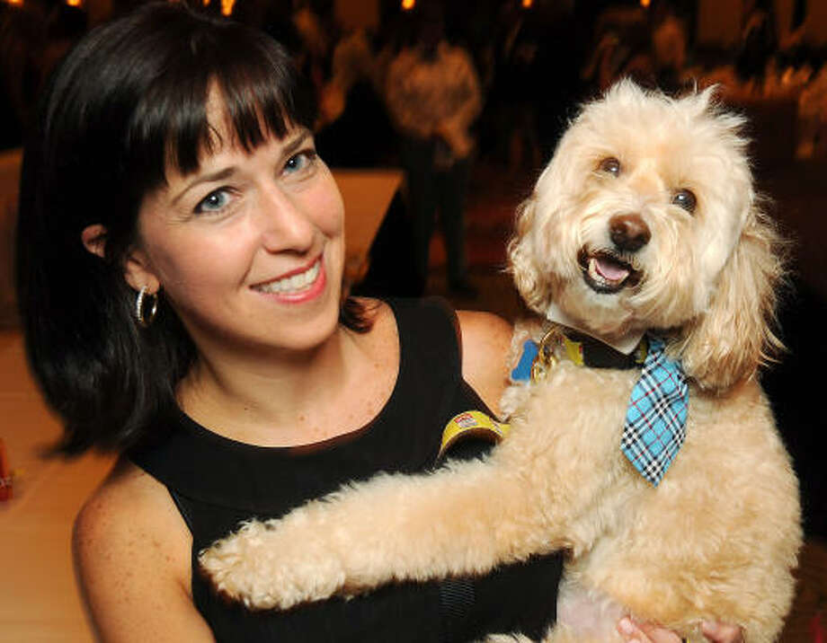 "Robin Susman with Parker at the Mr. Magoo's ""The Best Little Doghouse in Texas"" benefiting the Citizens for Animal Protection at the Hilton Americas Houston Saturday. Photo: Dave Rossman, For The Chronicle"