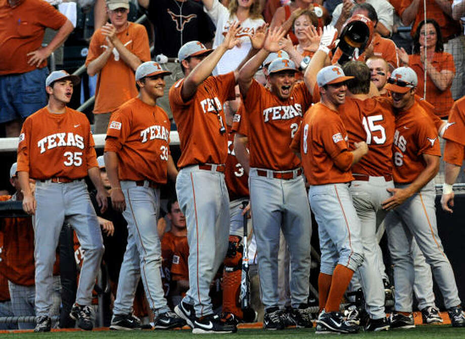 June 6: Texas 4, Rice 1 (Austin Regional) Texas' Russell Moldenhauer (15) celebrates with teammates after hitting a two-run home run in the eighth inning. Top-seeded Texas claimed the Austin Regional title with Sunday's win. Photo: Patrick Meredith, For The Chronicle