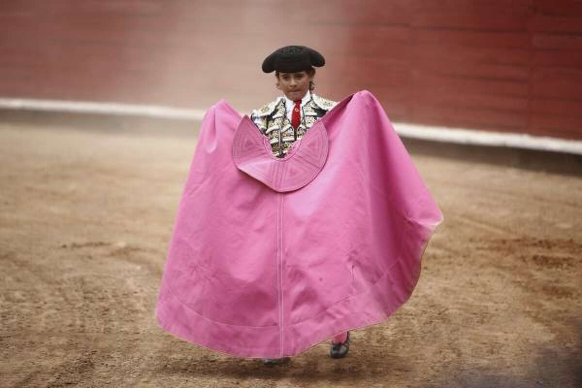 French-Mexican bullfighter Michel Lagravere, known as Michelito, bullfights in Mexico City, Sunday, June 6, 2010. Lagravere, 12, is the youngest bullfighter to perform in the Plaza de Toros Mexico.