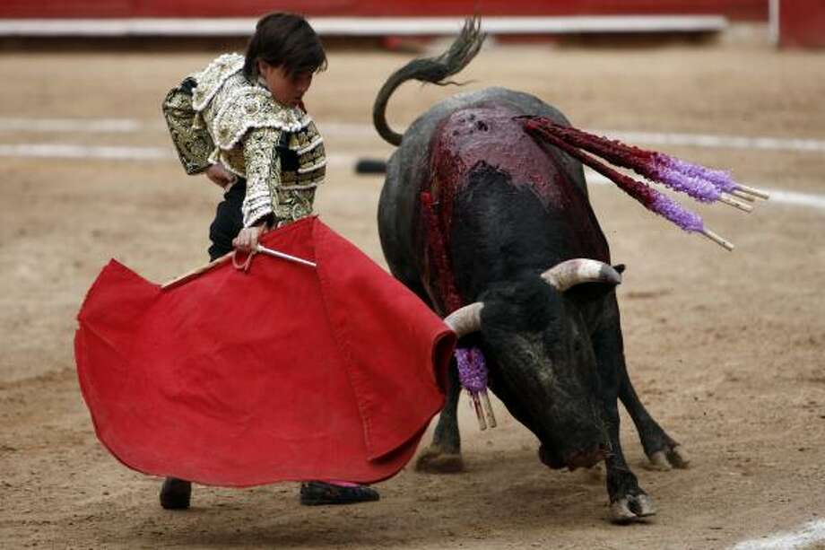 French-Mexican bullfighter Michel Lagravere, known as Michelito, bullfights in Mexico City, Sunday, June 6, 2010. Lagravere successfully killed his first bull, which weighed 893 pounds. Photo: Miguel Tovar, AP
