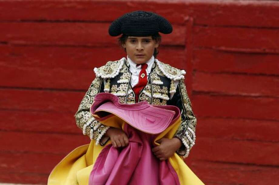 "French-Mexican bullfighter Michel Lagravere, known as Michelito, bullfights in Mexico City, Sunday, June 6, 2010. The boy told AP Television News from a stretcher that he was left ""with a good taste in my mouth"" from his appearance. Photo: Miguel Tovar, AP"