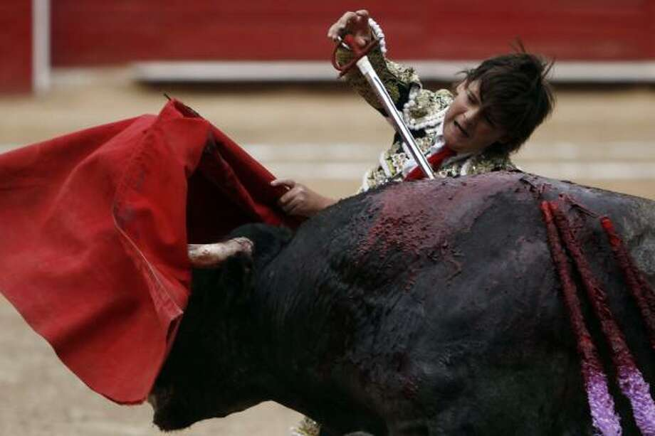 French-Mexican bullfighter Michel Lagravere, known as Michelito, bullfights in Mexico City, Sunday, June 6, 2010. Lagravere, 12, is the youngest bullfighter to perform in the Plaza de Toros Mexico. Photo: Miguel Tovar, AP
