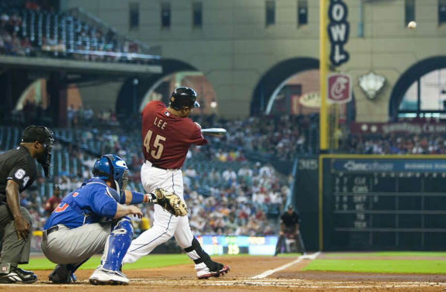 Carlos Lee hits a two-run homer off Cubs starter Randy Wells during the first inning. Photo: Brett Coomer, Chronicle