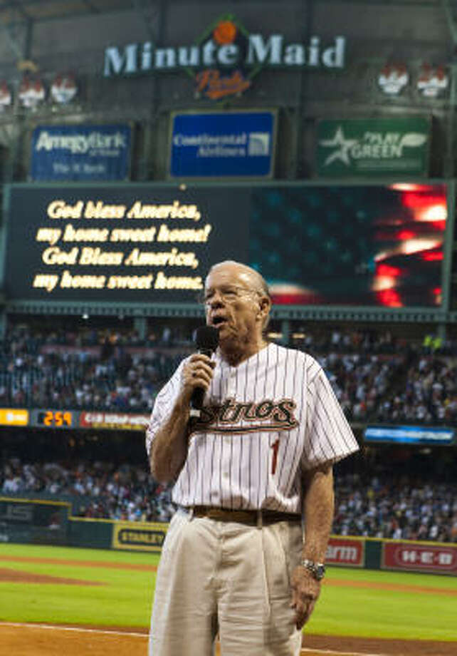 "Joe Prince sings ""God Bless America"" during the seventh-inning stretch. Photo: Brett Coomer, Chronicle"