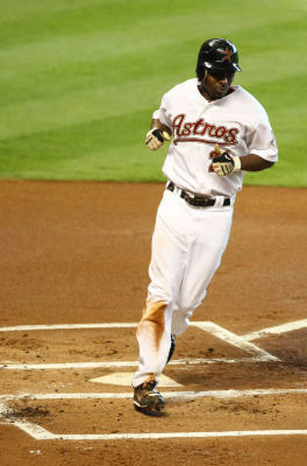 Michael Bourn easily crosses home for the Astros' first run of the game in the first inning. Photo: Nick De La Torre, Chronicle