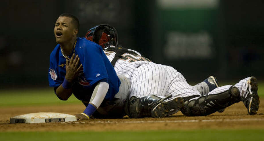 Cubs shortstop Starlin Castro and Astros catcher stumble by third base after a bunt in the fifth inning. Photo: Yasmeen Smalley, Chronicle