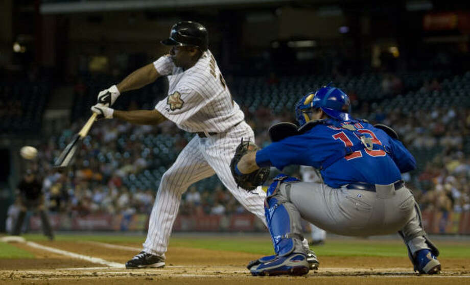 Astros center fielder Michael Bourn singles in the fifth, one of his three hits. Photo: Yasmeen Smalley, Chronicle