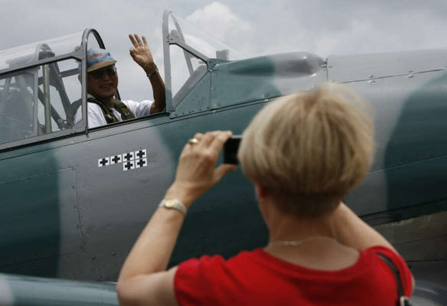 George Hirasaki, a professor at Rice University, got his ride in a T-6 Texan trainer as a Christmas gift from his wife, Darlene. Members of the public paid between $150 and about $500 to fly World War II-era planes. Photo: Julio Cortez, Chronicle