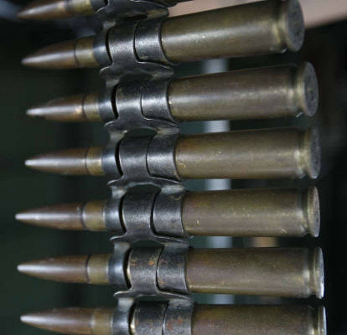 Displayed on a B-25 bomber fighter plane is 50-caliber ammunition for machine guns.