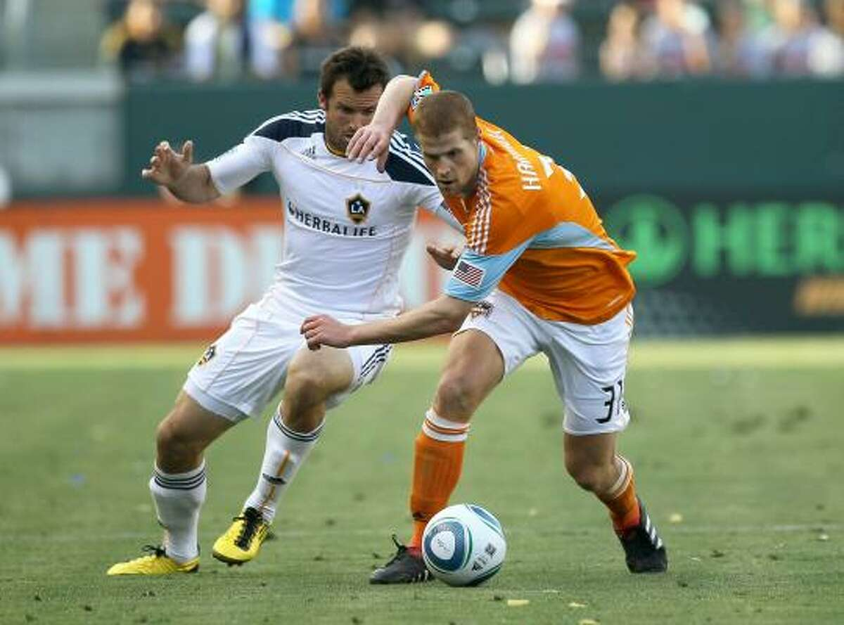 Dynamo defender Andrew Hainault, right, fights with Los Angeles' Chris Klein for the ball. The Galaxy won 4-1.
