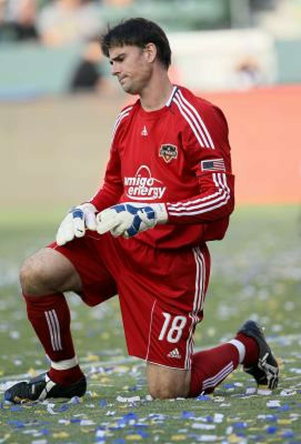 Dynamo goalkeeper Pat Onstad grimaces after giving up the fourth goal of the game.
