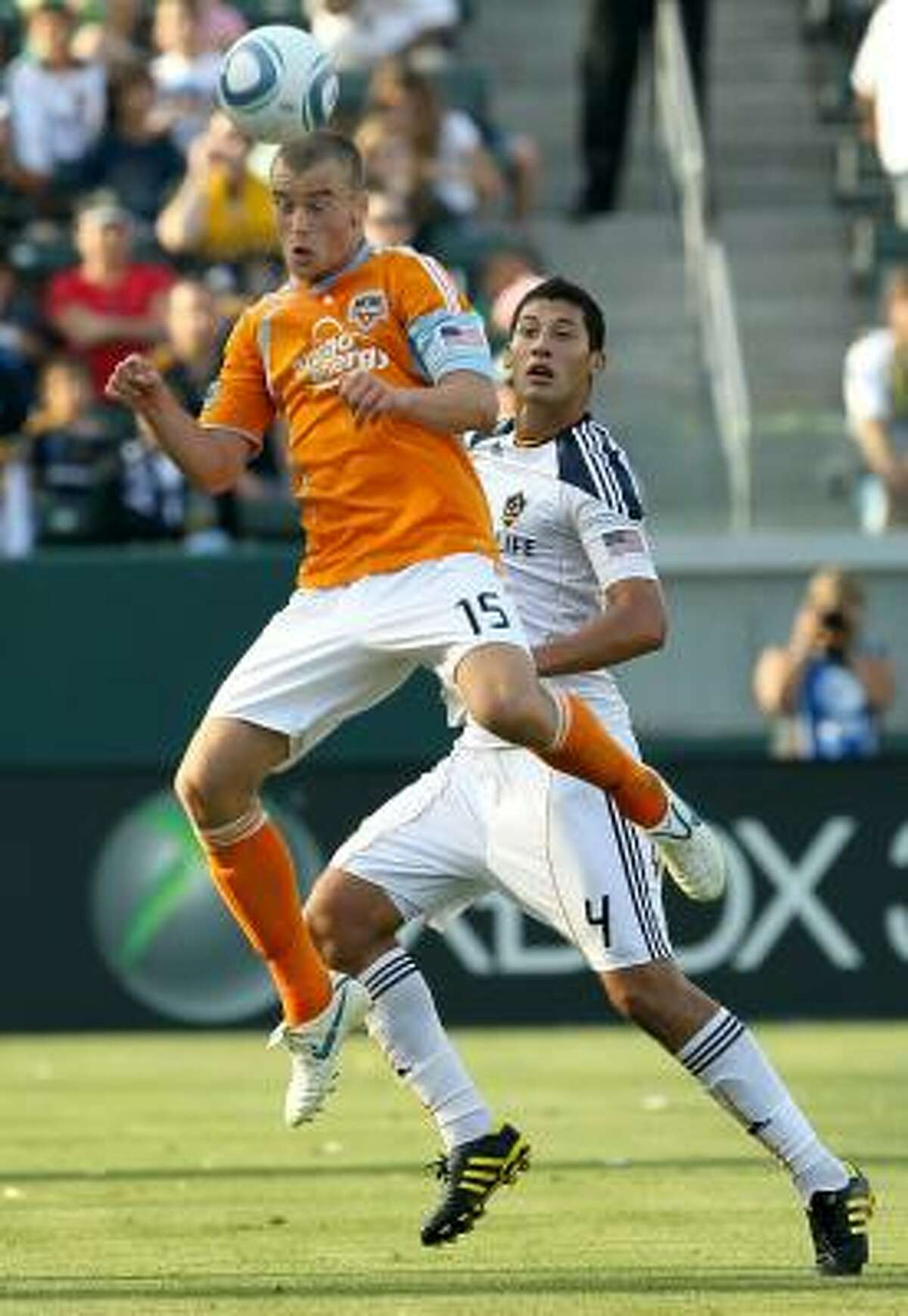 Cam Weaver jumps to head the ball in front of Los Angeles' Omar Gonzalez.