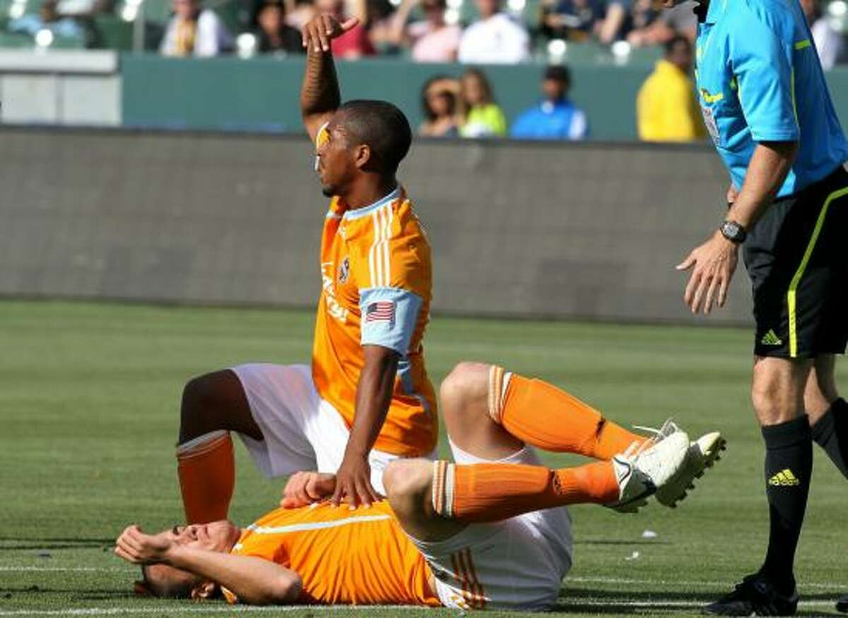 Corey Ashe signals for help after Craig Waibel was injured while scoring a goal.