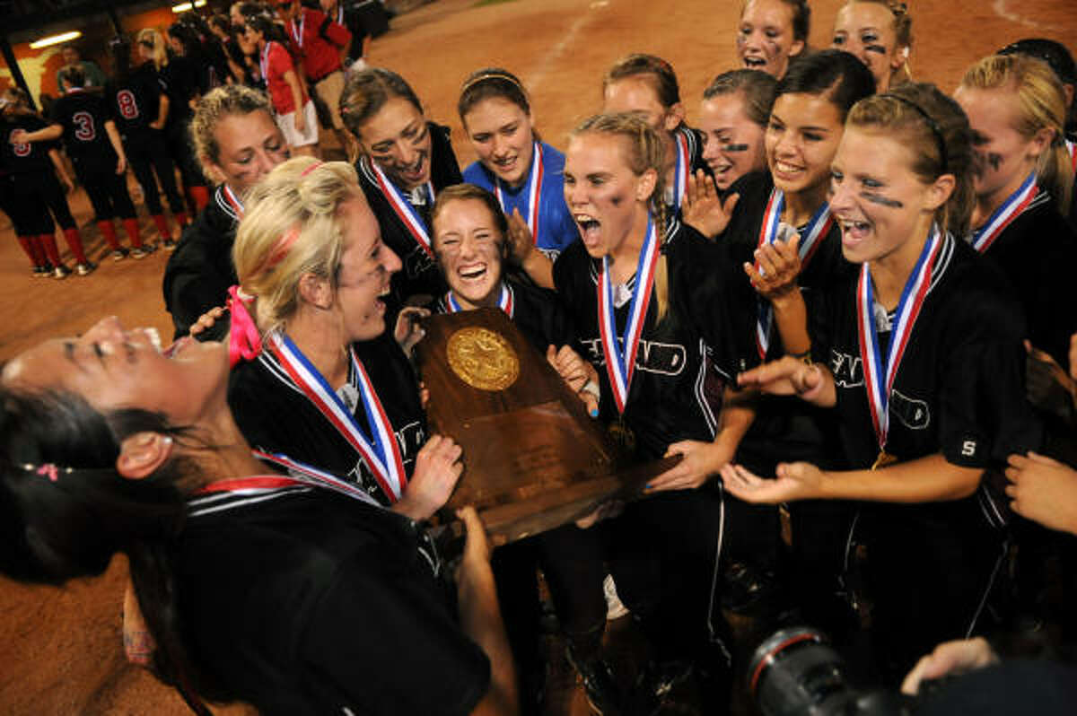 June 5: Pearland 4, Austin Bowie 0 Pearland senior outfielder Destini Smith, center, and her teammates hold the Class 5A state softball championship trophy after defeating Austin Bowie at McCombs Field on Saturday in Austin. The Oilers won their first state title since 1996.