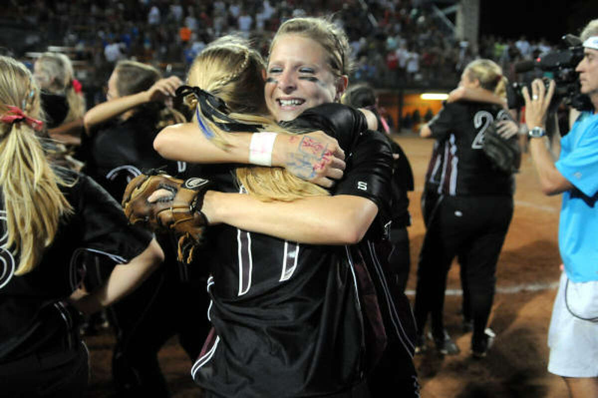 Pearland's Courtney Sams shares a hug with teammate Stacie Pilkington after Saturday's win.