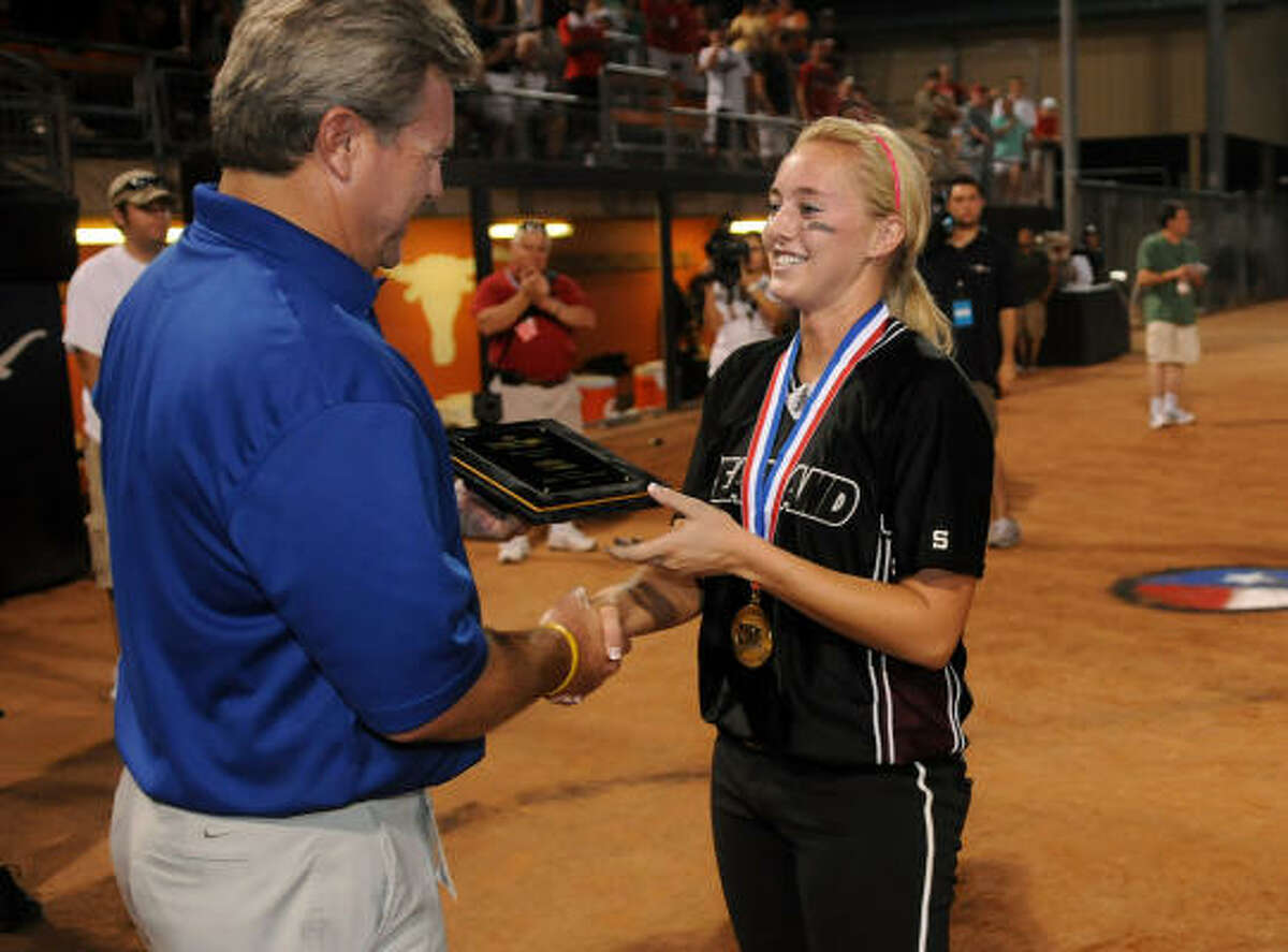 Pearland senior shortstop Jaclyn Bechtle accepts the Class 5A tournament MVP trophy. Bechtle went 3-for-4 with an RBI in Saturday's championship game.