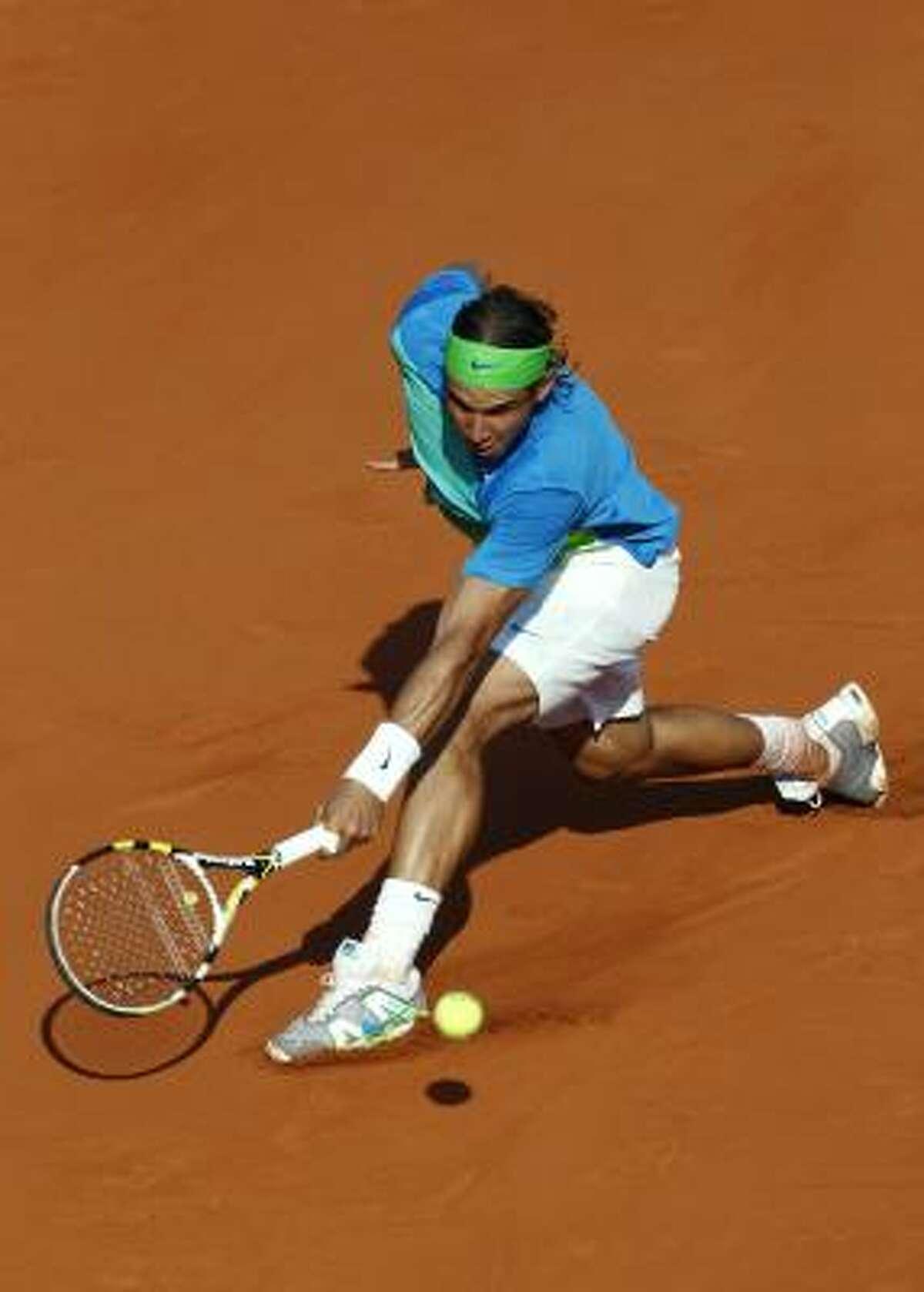 Spain's Rafael Nadal returns the ball to Jurgen Melzer.