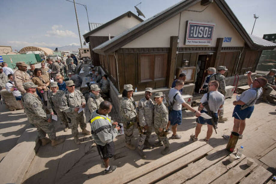 Nearly 350 troops, men and women, came to the USO's Pat Tillman Memorial Center and lined up around the building, waiting their turn to meet and talk with NFL Pro Bowlers. Photo: DAVE GATLEY, USO Photo By DAVE GATLEY