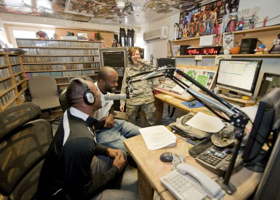 Vernon Davis, left, and Mario Williams record a spot in the Armed Forces Network studios. Photo: DAVE GATLEY, USO Photo By DAVE GATLEY