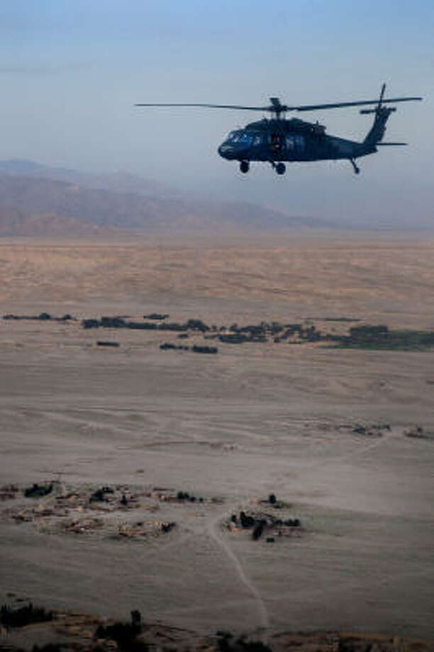 Flying over much of the Eastern portion of the country of Afghanistan by helicopter, in this case - a Blackhawk, allowed these NFL players the opportunity to see the way the people lived. Photo: DAVE GATLEY, USO Photo By DAVE GATLEY