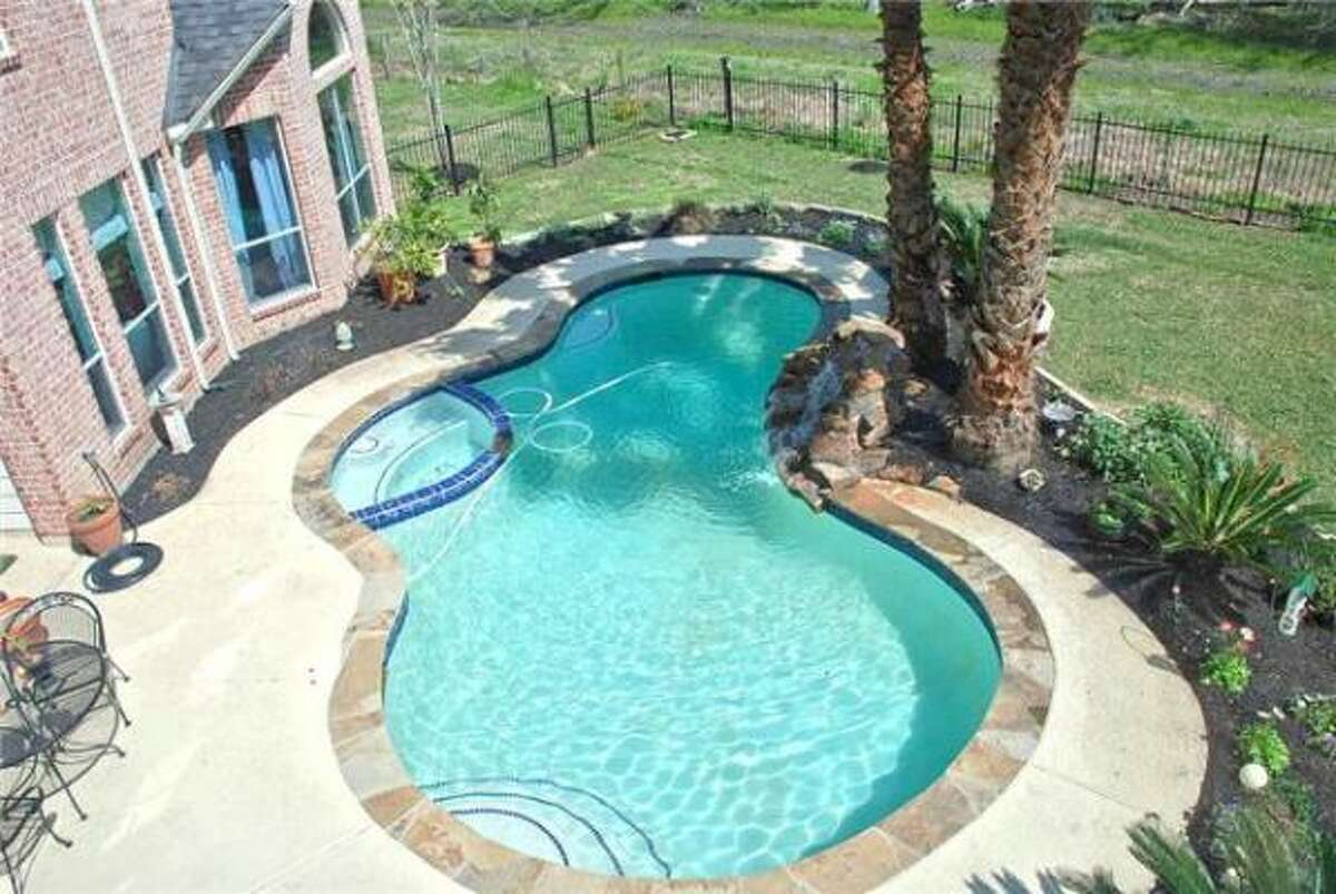 Check out the pool at this four bedroom home in Richmond. See the complete listing and price here.