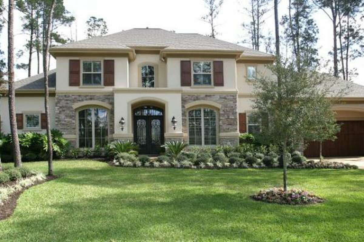 This stone and stucco home has five bedrooms and 5.5 bathrooms. It costs $1,075,000. See the inside here.