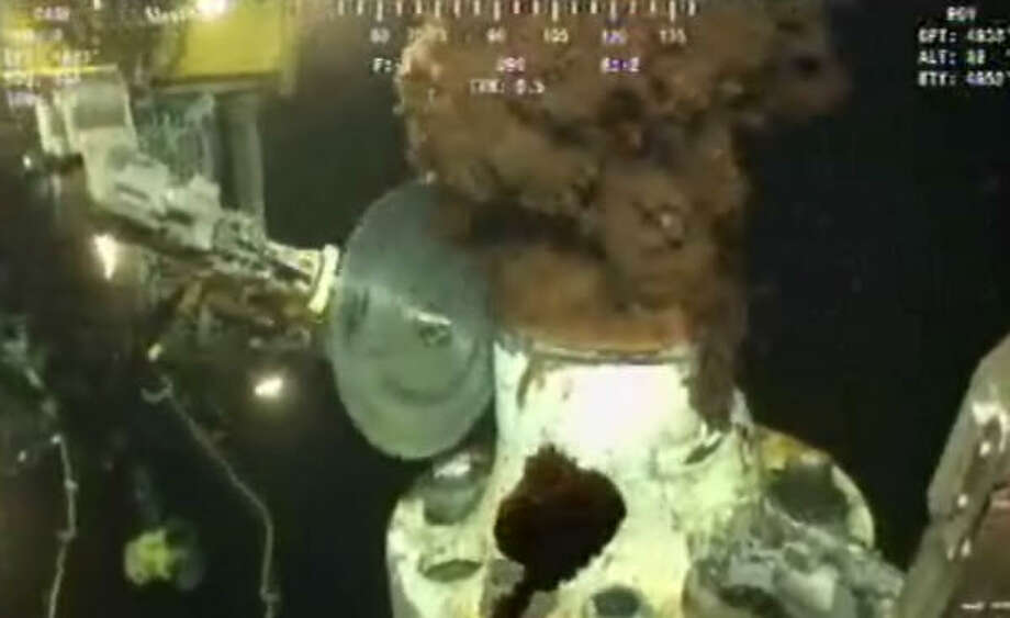 In this image made from video released by BP, a saw trims part of the blowout preventer at the site of the Deepwater Horizon oil spill on Thursday June 3, 2010 in preparation for a capping device that will be lowered in hopes of sealing the leak. Photo: AP
