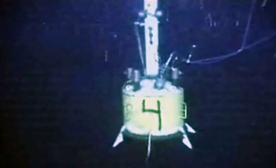 In this image made from video made available by BP, a capping device hangs in the water at the site of the Deepwater Horizon oil spill on Thursday June 3, 2010. Photo: AP
